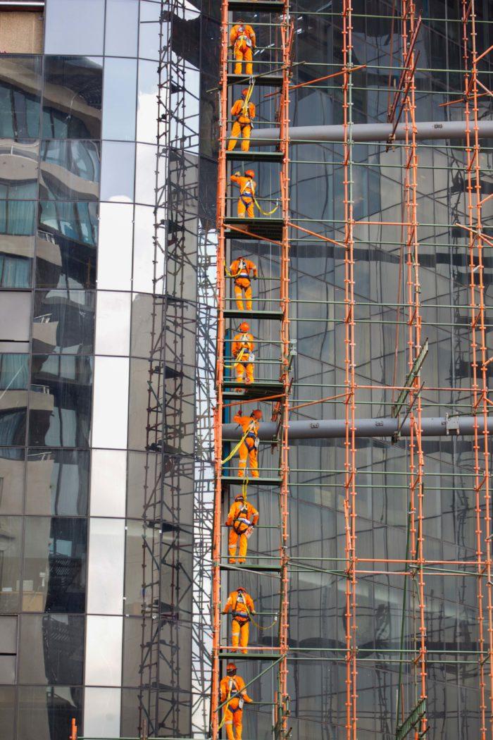 Workers building skyscraper